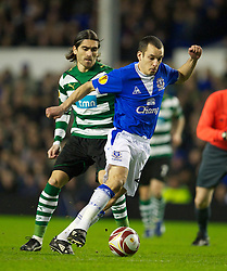 LIVERPOOL, ENGLAND - Tuesday, February 16, 2010: Everton's Leon Osman and Sporting Clube de Portugal's Pedro Mendes during the UEFA Europa League Round of 32 1st Leg match at Goodison Park. (Photo by: David Rawcliffe/Propaganda)