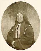 vintage photo of a nun posing for a portrait