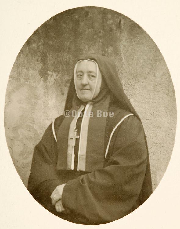 vintage photo of a nun posing for a portrait