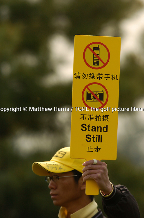 Chinese marshal holds up 'no photos' and 'no mobiles' sign during Johnnie Walker Asian Classic 2005, Pine Valley Golf Resort & Country Club, Changping District,Beijing,China