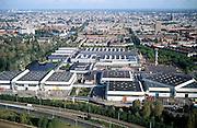 Nederland, Amsterdam, Zuidas, Europaplein, 25-09-2002; tentoonstellingshallen van de RAI (Rijwiel Automobiel Industrie), in de voorgrond Ringweg A10; direct boven de RAI toren de hoogbouw van het Okura hotel met daarachter de dubbele torens van de Nederlandse bank; expo, beurs, economie, bedrijvigheid, toerisme, stadsgezicht, vogelvlucht;<br /> luchtfoto (toeslag), aerial photo (additional fee)<br /> foto /photo Siebe Swart