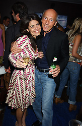 Designer DANIELLA HELAYEL and MR PETER SIMON at a party to view the designs of Jessica Simon at the beginning of London Fashion Week held at The Electric Cinema, Portabello Road, London on 19th September 2004.<br />