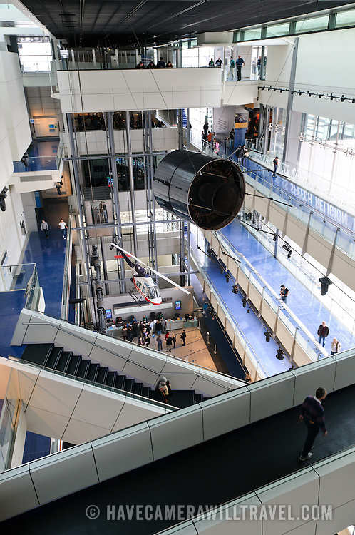 A communications satellite is suspended high above the main hall of the Newseum in Washington DC. The Newseum is a 7-story, privately funded museum dedicated to journalism and news. It opened at its current location on Pennsylvania Avenue in April 2008.