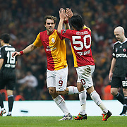 Galatasaray's Johan Elmander (L) celebrate his goal with team mate during their Turkish superleague soccer derby match Galatasaray between Besiktas at the TT Arena at Seyrantepe in Istanbul Turkey on Sunday, 26 February 2012. Photo by TURKPIX
