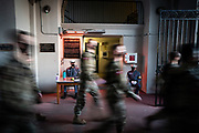 Cadets sitting guard in the sallyport of Padgett-Thomas Barracks watch as knobs depart for a training exercise at The Citadel in Charleston, South Carolina on Saturday, February 27, 2021.<br /> <br /> Credit: Cameron Pollack / The Citadel