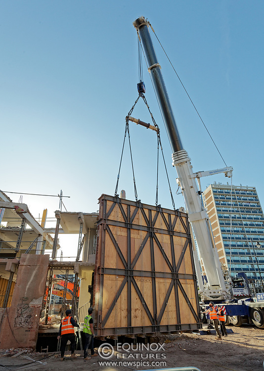 London, United Kingdom - 20 September 2019<br /> EXCLUSIVE SET - Aerial construction specialists and demolition experts use a huge crane to carefully lift intact, a twenty five ton, two-story wall, to preserve a famous Banksy rat image which has been covered up for years. Teams from specialist companies have spent over six weeks cutting around the artwork and fitting custom made eight ton steel supports to enable them to save the historic piece of art. Work has started on the construction of a new twenty seven floor art'otel hotel on the site of the old Foundry building in Shoreditch, east London, and a condition of the planning permission was to preserve the historical Banksy graffiti. A second section of the painting, an image of a TV being thrown through a broken window has already been cut out and moved separately. After the hotel construction is complete the two parts of the Banksy painting will be displayed on the hotel. Our pictures show the stages of work to protect the image, culminating in the lifting of the three story wall by crane. Video footage also available.<br /> (photo by: EQUINOXFEATURES.COM)<br /> Picture Data:<br /> Photographer: Equinox Features<br /> Copyright: ©2019 Equinox Licensing Ltd. +443700 780000<br /> Contact: Equinox Features<br /> Date Taken: 20190920<br /> Time Taken: 17100792<br /> www.newspics.com