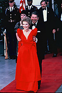 President Ronald Reagan and First Lady Nancy Reagan wait for President De La Madrid of Mexico as he arrives for a state dinner on May 15, 1984<br />Photo by Dennis Brack