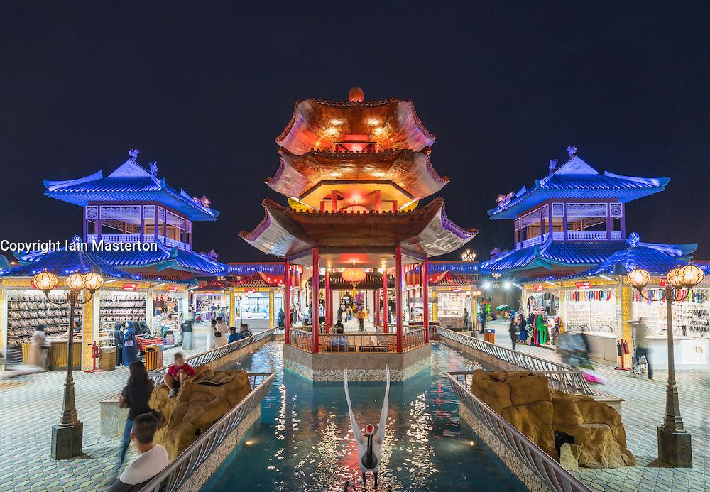 Illuminated China Pavilion at night at Global Village 2015 in Dubai United Arab Emirates