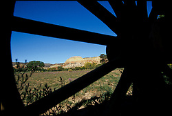 North America, United States, New Mexico, Ghost Ranch, sandstone butte viewed through wagon wheel
