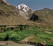 View over Baba-Tangi (6513m). Behind this mountain, Pakistan and the village of Lasht in Chitral.<br /> <br /> Adventure through the Afghan Pamir mountains, among the Afghan Kyrgyz and into Pakistan's Karakoram mountains. July/August 2005. Afghanistan / Pakistan.