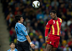 Mauricio Victorino of Uruguay vs Asamoah Gyan of Ghana during to the 2010 FIFA World Cup South Africa Quarter Finals football match between Uruguay and Ghana on July 02, 2010 at Soccer City Stadium in Sowetto, suburb of Johannesburg. (Photo by Vid Ponikvar / Sportida)