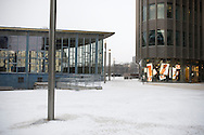A disused building (left), part of the former border crossing of the Berlin Wall at Friedrichstrasse in the city centre. The route of the Wall, which stood from 1962-1989, has been developed into the 'Mauerweg,' a thoroughfare which traces most of the route of the Wall which encircled the city and divided it into East and West Berlin during the Cold War. In the years following the 1989 civil uprising in the German Democratic.Republic, most of the Wall was removed as part of the reunification strategy which united the pro-Soviet DDR and the Federal Republic of (West) Germany.