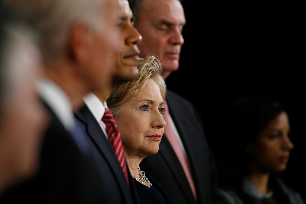 Senator Hillary Clinton, middle, Obama's nominee for Secretary of State, between President-Elect Barack Obama, and retired Marine General James L. Jones, nominated as national security adviser, listen to Obama's nominee for Attorney General, Eric Holder, at a press conference at the Chicago Hilton & Towers.