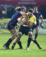 Todd Clever (L) of USA tries to stop Mihai Macovei (R) of Romania during their  rugby test match between Romania and USA, on National Stadium Arc de Triomphe in Bucharest, November 8, 2014.  Romania lose the match against USA, final score 17-27.