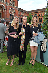 Left to right, DONNA AIR, JAMES BROWN and FRIDA LOURIE at the V&A Summer Party in association with Harrod's held at The V&A Museum, London on 22nd June 2016.
