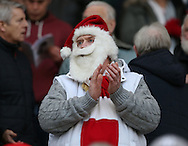 A fan dressed as Father Christmas in the stands during the English Premier League match at the Bet 365 Stadium, Stoke on Trent. Picture date: December 17th, 2016. Pic Simon Bellis/Sportimage