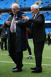 21st October 2017 - Premier League - Manchester City v Burnley - Former Man City player Mike Summerbee presents BBC Commentator John Motson with a blue coat before the match to mark his final season in the job - Photo: Simon Stacpoole / Offside.