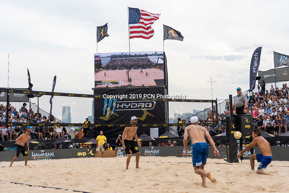 Taylor Crabb/Jake Gibb competing against Tri Bourne/Trevor Crabb  in the 2019 New York City Open Beach Volleyball