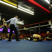 Curits Vert fights with Michael Guillen during the Mad Integrity Fight sports boxing match at the Florida Orange Event Center in Lakeland, Florida on Saturday October 10, 2015. Photo: Alex Menendez