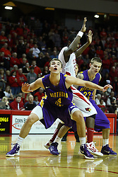 29 December 2011:  Chip Rank gets position on John Wilkins during a free throw attempt during an NCAA mens basketball game between the Northern Illinois Panthers and the Illinois State Redbirds in Redbird Arena, Normal IL