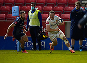 Exeter Chiefs No.8 Sam Simmonds rounds Sale Sharks wing Byron McGuigan to score during a Gallagher Premiership Round 11 Rugby Union match, Friday, Feb 26, 2021, in Eccles, United Kingdom. (Steve Flynn/Image of Sport)