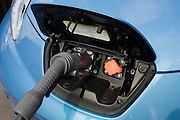 Fast charging a Nissan Leaf electric car at an electrical charging point offering an EV 30 minute charge. The Nissan Leaf (an acronym for Leading, Environmentally friendly, Affordable, Family car is a five-door hatchback electric car manufactured by Nissan and introduced in Japan and the United States in December 2010. The US Environmental Protection Agency official range is 117 kilometres (73 mi), with an energy consumption of 765 kilojoules per kilometre (34 kW·h/100 mi) and rated the Leaf's combined fuel economy at 99 miles per gallon gasoline equivalent (2.4 L/100 km). The Leaf has a range of 175 km (109 mi) on the New European Driving Cycle.