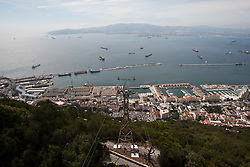 The harbour and Bay of Gibraltar. Photographs from the top of the Rock of Gibraltar. Images of Gibraltar, the British overseas territory located on the southern end of the Iberian Peninsula at the entrance of the Mediterranean.