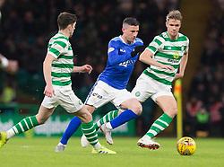 St Johnstone's Michael O'Halloran (centre) beats Celtic's Ryan Christie (left) and Kristoffer Ajer (right) during the Ladbrokes Scottish Premiership match at Celtic Park, Glasgow.