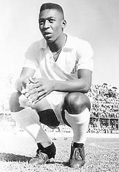 Edson Arantes do Nascimento, also called Pele, squatting on a football field. 1961 (Credit Image: © Mondadori Portfolio via ZUMA Press)