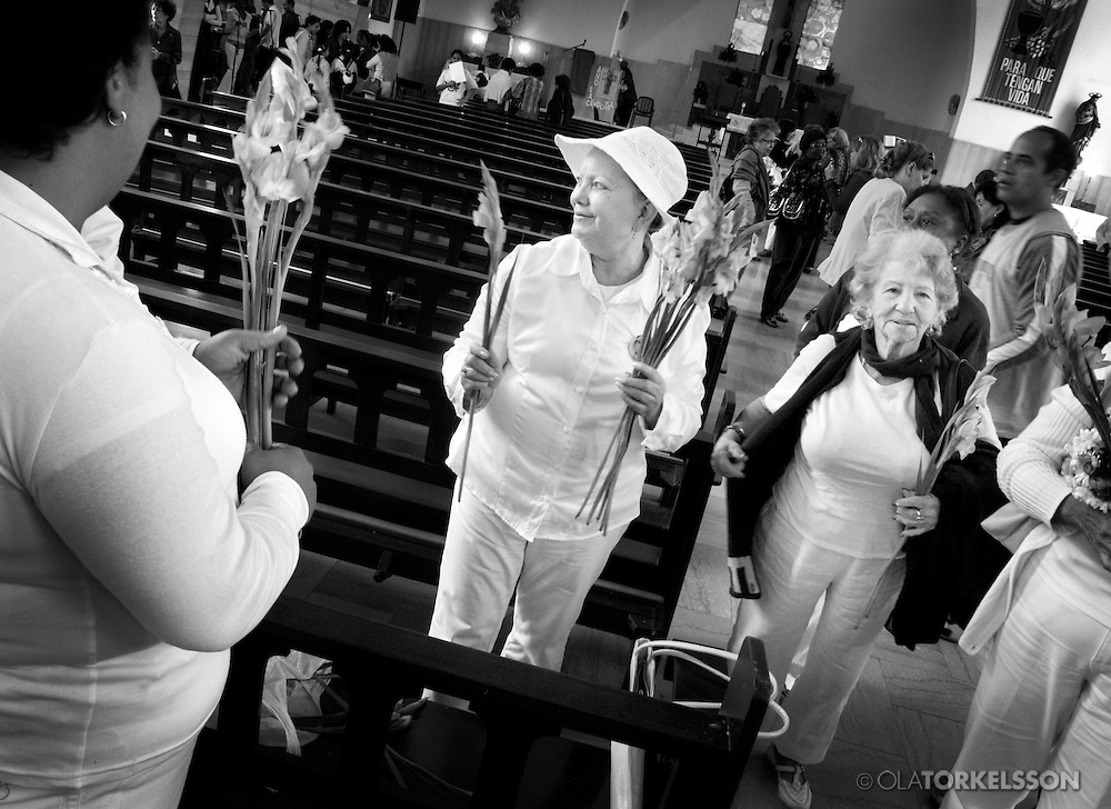 The White Ladies gather at a church in Havana, Cuba, on Sundays. First the go to church and after they walk in silence with flowers in their hands to protest against the regime.<br /> For more details contact the photographer.<br /> Photo Ola Torkelsson<br /> Copyright Ola Torkelsson ©