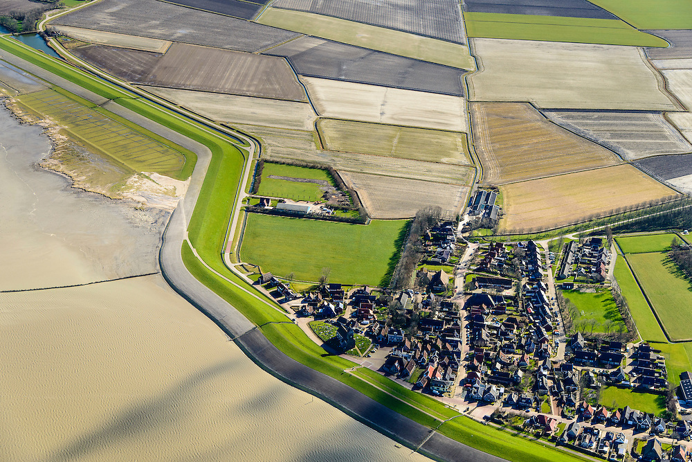 Nederland, Friesland, Gemeente Ferwerderadeel, 28-02-2016; Wierumer Wad met Wierum in de voorgrond.  Zeedijk van de Waddenzee op Deltahoogte.<br /> <br /> Land reclamation, inland polders as a result of reclaiming former salt marsh area outside the dikes.<br /> <br /> luchtfoto (toeslag op standard tarieven);<br /> aerial photo (additional fee required);<br /> copyright foto/photo Siebe Swart