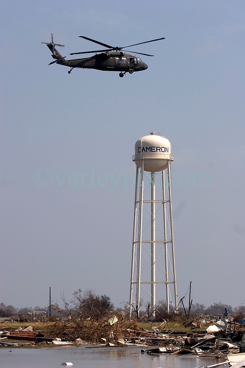 26th Sept, 2005. Cameron, Louisiana.  Hurricane Rita aftermath.<br /> The destroyed remains of downtown business in Cameron, Louisiana two days after the storm ravaged the small town. An army helicopter comes in to land close to the water tower, one of the few remaining structures in the town.<br /> Photo; ©Charlie Varley/varleypix.com