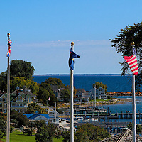 """""""Flags Over Mackinac""""<br /> <br /> A beautiful scene from atop Mackinac Island gazing down into the harbor and town with flags flying high!"""