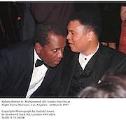 Sidney Poitier &  Muhammad Ali, Vanity Fair Oscar Night Party. Mortons. Los Angeles.  24 March 1997<br /><br />Copyright Photograph by Dafydd Jones<br />66 Stockwell Park Rd. London SW9 0DA<br />Tel 0171 733 0108