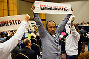 BIRMINGHAM, AL –SEPTEMBER 16, 2012: Undocumented Hispanic protestor Jose Mangandi, 50,  is escorted out of a briefing on the civil rights effects of state immigration law held by the U.S. Commission on Civil Rights in Birmingham, Alabama on August 17, 2012. Mangandi is one of several undocumented Latinos traveling across the country on the Undocubus.