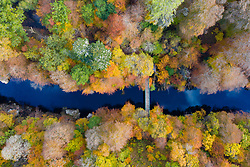 Killiecrankie, Perthshire, Scotland, UK. 28th October 2019. Autumnal colours in trees beside the River Garry seen from a drone at Killiecrankie in Perthshire. Pictured; Pedestrian footbridge crossing the River Garry. Iain Masterton/Alamy Live News. Killiecrankie, Perthshire, Scotland, UK. 28th October 2019. Autumnal colours in trees beside the River Garry seen from a drone at Killiecrankie in Perthshire.