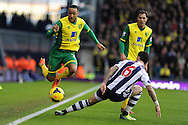 Norwich city's Nathan Redmond (l) skips past Liam Ridgwell of WBA. Barclays Premier league, West Bromwich Albion v Norwich city at the Hawthorns in West Bromwich, England on Sat 7th Dec 2013. pic by Andrew Orchard, Andrew Orchard sports photography.