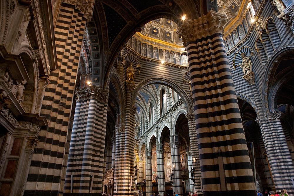 Interior of the Duomo di Santa Maria Assunta, Siena Cathedral with it's striped walls and columns