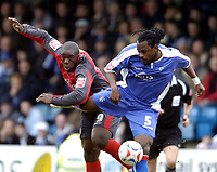 Photo: Olly Greenwood.<br />Gillingham v Swansea City. Coca Cola League 1. 25/03/2006. Swansea's Adebayo Akinfenwa (L) and Gillingham's Brent Sancho battle.