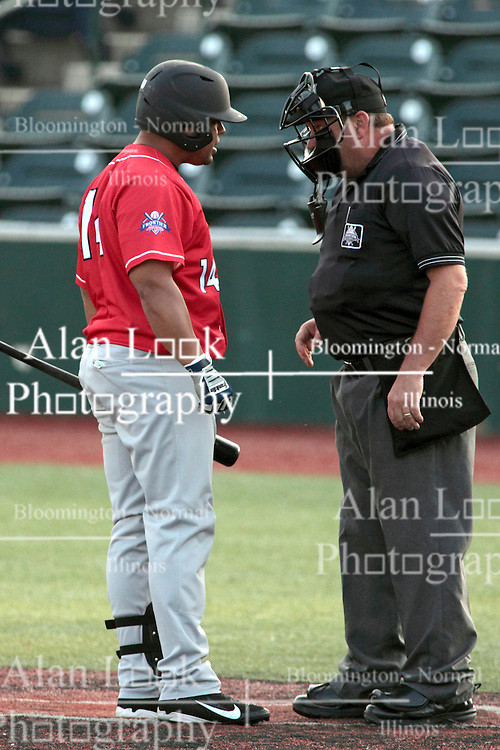 26 July 2014:  Anderson Hildago argues a called 3rd strike with plate umpire Steve Dunahue during a Frontier League Baseball game between the Lake Erie Crushers and the Normal CornBelters at Corn Crib Stadium on the campus of Heartland Community College in Normal Illinois