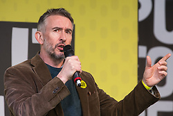 London, UK. 23rd March, 2019. Comedian Steve Coogan addresses a million people taking part in a People's Vote rally in Parliament Square following a march from Park Lane.
