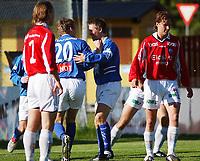 Christian Steen, Aalesund, gratulereres med scoring og jubler sammen med Amund Skiri, Aalesund. Espen Nystuen, Kongsvinger, fortviler.<br /> <br /> Fotball: Kongsvinger - Aalesund 2-2 (5-2 e. straffer). NM 2004 herrer, 3. runde. 8. juni 2004. (Foto: Peter Tubaas/Digitalsport.