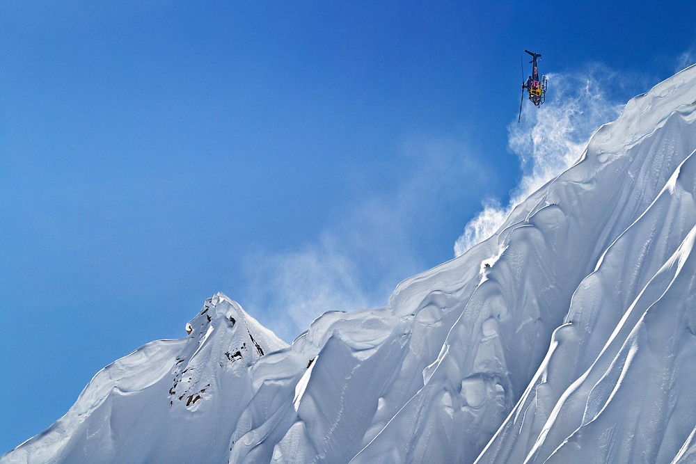 John Jackson is chased by a helicopter while snowboarding down a spine in the Alaska backcountry during the making of the film The Art of Flight.