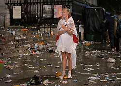 © Licensed to London News Pictures. 11/07/2021. London, UK. A supporter stands in the street near Trafalgar Square, central London after England lost to Italy in the EURO 2020 final. Photo credit: Peter Macdiarmid/LNP