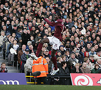 Photo: Lee Earle.<br /> Fulham v Arsenal. The Barclays Premiership. 04/03/2006. Arsenal's Emmanuel Eboue jumps for joy after scoring their second.