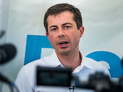 "13 AUGUST 2019 - DES MOINES, IOWA: PETE BUTTIGIEG answers reporters' questions at a ""press gaggle"" at the Iowa State Fair. Buttigieg, the Mayor of South Bend, Indiana, is running to be the Democratic nominee for the US presidency. He spoke at the Des Moines Register Political Soap Box at the Iowa State Fair and then toured the fairgrounds. Iowa has the first event of the presidential selection cycle. The Iowa Caucuses are February 3, 2020.               PHOTO BY JACK KURTZ"