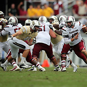 South Carolina Gamecocks quarterback Dylan Thompson (17) outruns UCF Knights defensive lineman Blake Keller (48) during an NCAA football game between the South Carolina Gamecocks and the Central Florida Knights at Bright House Networks Stadium on Saturday, September 28, 2013 in Orlando, Florida. (AP Photo/Alex Menendez)