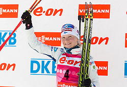 Winner MAKARAINEN Kaisa of Finland celebrates during flower ceremony after the Women 10 km Pursuit competition of the e.on IBU Biathlon World Cup on Saturday, March 8, 2014 in Pokljuka, Slovenia. Photo by Vid Ponikvar / Sportida