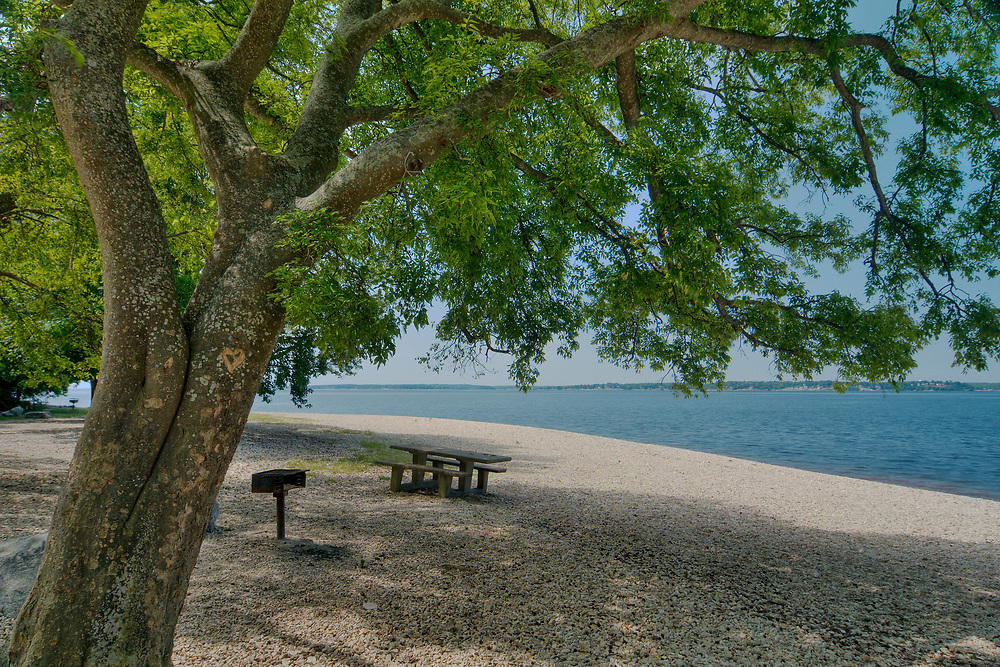 The white pebble beach along Kentucky Lake in the Moss Creek Day Use Area at the Land Between the Lakes National Recreation Area in Tennessee & Kentucky on Wednesday, August 2, 2017. Copyright 2017 Jason Barnette