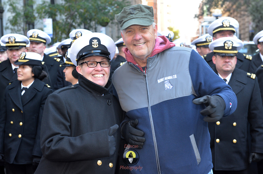 """NEW YORK -- USS Hué City (CG 66) Command Master Chief Teri Zehnacker of Decatur, Ill. poses with Jim Wagner of Chicago, a Marine who served at the Battle of Hué City, for which the ship is named, before the 2017 Veterans Day parade.  The ship is in port participating in Veterans Week New York City 2017 to honor the service of all our nation's veterans. <br /> Wagner joined the ship's crew for a short """"tiger"""" cruise from Florida to New York this week. <br />  #USNavy, #NavyInNYC, #VeteransDay, #USNavy, #VeteransDay #NeverForget (U.S. Navy photo by Chief Mass Communication Specialist Roger S. Duncan/ Released)"""